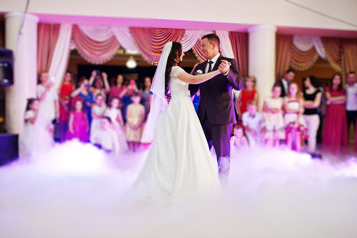 wedding dance with smoke and rose purple lights.
